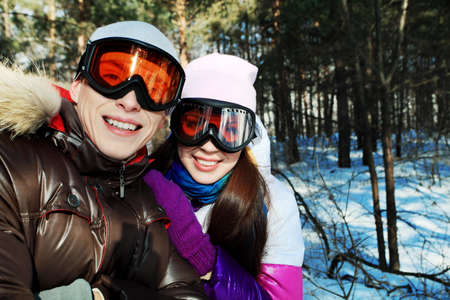 Portrait of a happy young couple having a rest in winter park. Stock Photo - 6939524