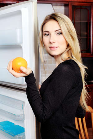 Young woman on a kitchen at home. photo