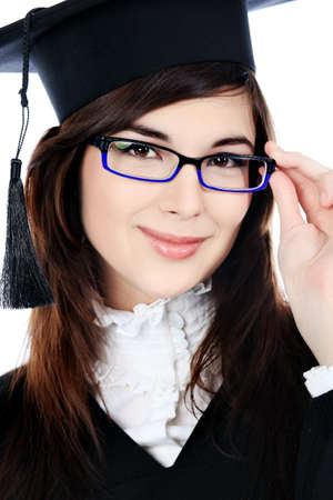 Educational theme: graduating student girl in an academic gown. Isolated over white background. Stock Photo - 7001450