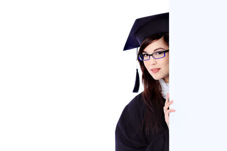 careerist: Educational theme: graduating student girl in an academic gown holding a billboard. Isolated over white background.