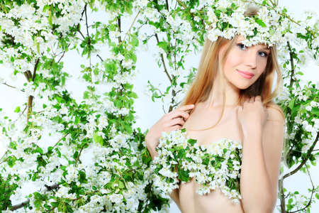Portrait of a beautiful spring girl in apple tree flowers. Stock Photo - 7040491