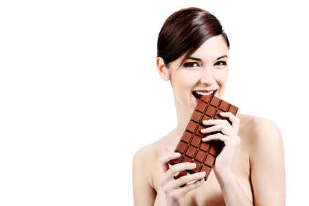 Shot of a beautiful young woman holding big chocolate bar. photo