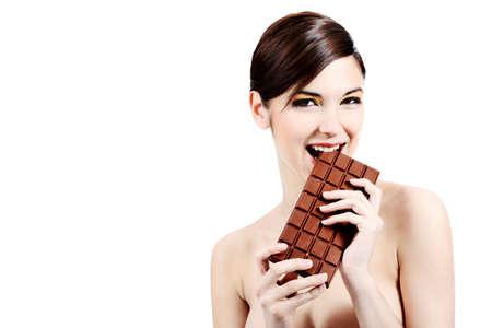 Shot of a beautiful young woman holding big chocolate bar. photo