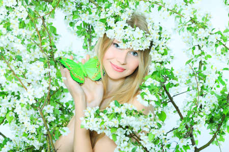 Portrait of a beautiful spring girl in apple tree flowers. photo
