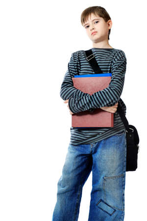 cute teen boy: Educational theme: boy teenager with books. Isolated over white background. Stock Photo