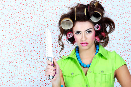 Shot of a funny  woman housewife dressed in retro style. Stock Photo - 7083275
