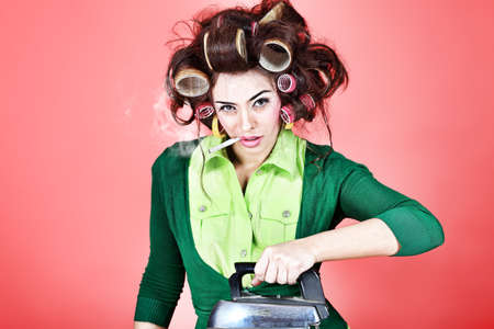 Shot of a funny  woman housewife dressed in retro style.  photo