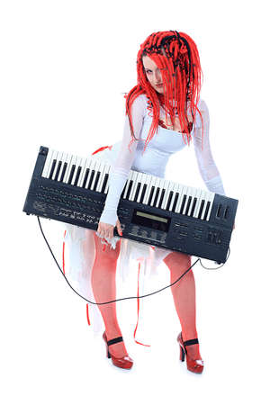 synthesizer: Rock musician is playing synthesizer. Shot in a studio. Stock Photo