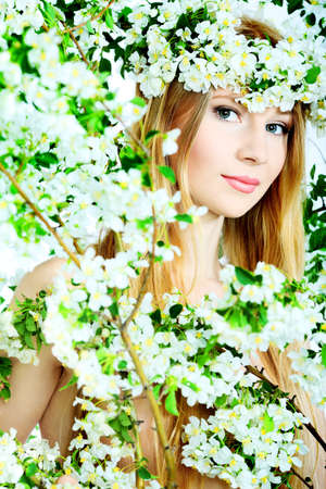 Portrait of a beautiful spring girl in apple tree flowers. Stock Photo - 7125338