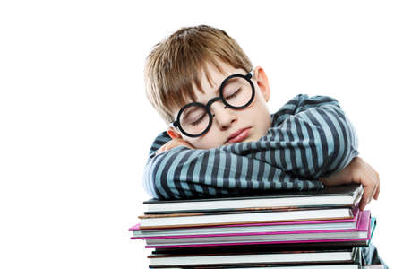 Educational theme: boy teenager sleeping on his books. Isolated over white background. photo