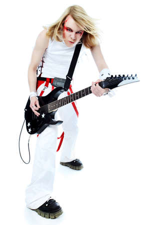 Rock musician is playing electrical guitar. Shot in a studio. photo