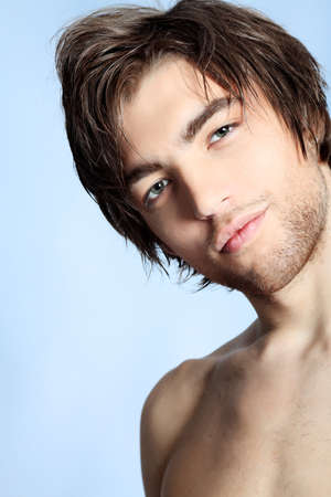 seducer: Portrait of a handsome muscular young man. Shot in a studio. Stock Photo