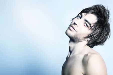 the tempter: Portrait of a handsome muscular young man. Shot in a studio. Stock Photo