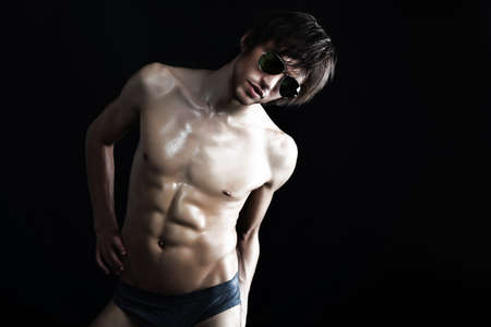 male underwear model: Portrait of a handsome muscular young man. Shot in a studio. Stock Photo