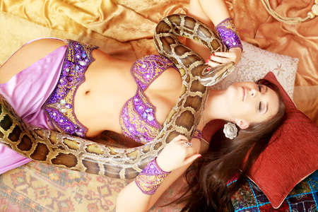 Shot of an oriental woman posing with a python.  photo