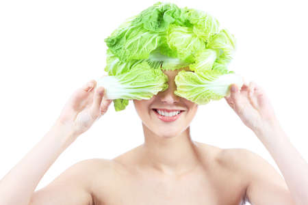 Shot of a beautiful young woman with cabbage headwear. Food concept, healthcare. Stock Photo - 7367317