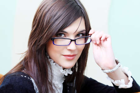 fashion glasses: Business theme: beautiful businesswoman working at the office.