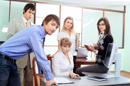 Group of business people interacting together at the office. photo
