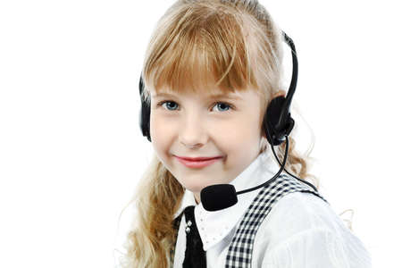 Shot of a little girl in headphones with microphone. Isolated over white background. photo