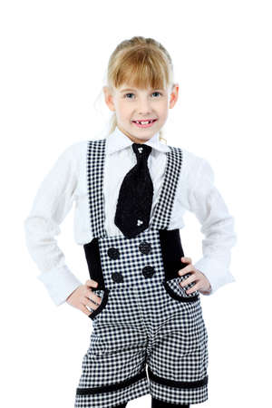 Shot of a little girl in a suit. Isolated over white background. photo