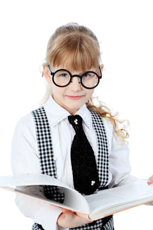 Shot of a little girl in glasses standing with books. Isolated over white background. photo