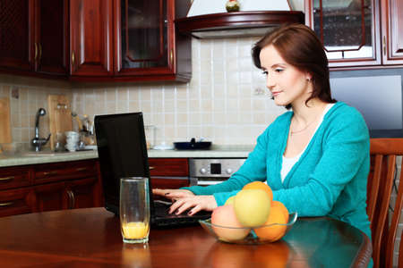 outwork: Young woman with her laptop at home.