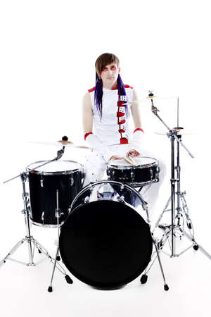 Rock drummer is playing his instruments. Shot in a studio. photo