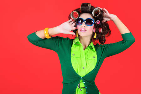 funny glasses: Shot of a funny  woman housewife dressed in retro style.