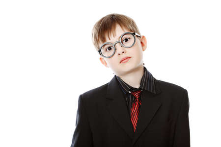 graduation suit: Educational theme: boy teenager posing in a suit and spectacles. Isolated over white background.