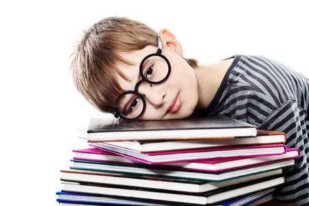 schoolboys: Educational theme: funny teenager with books. Isolated over white background. Stock Photo