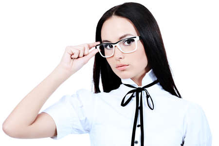 Beautiful young woman posing in business suit and glasses. Isolated over white background. Stock Photo - 7323298