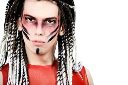 Artistic young man with dreadlocks and red make-up. Shot in a studio. Stock Photo - 7353273