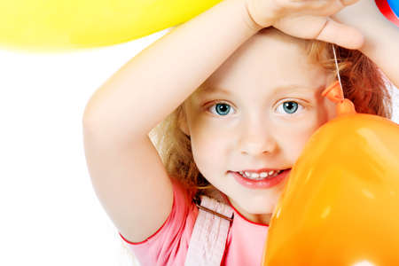 Portrait of a little girl with balloons. Isolated over white background. Stock Photo - 7377194