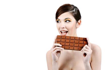 Shot of a beautiful young woman holding big chocolate bar. Stock Photo - 7377182