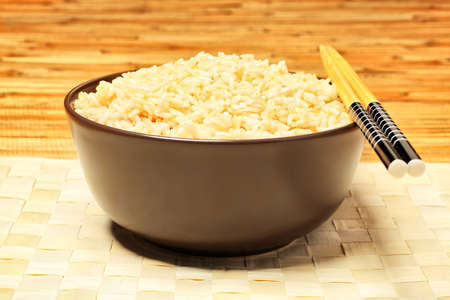 Steamed long rice in a brown bowl with chopsticks. Stock Photo - 7389883
