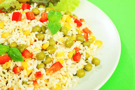 Steamed long rice with green peas, corn and pepper. photo