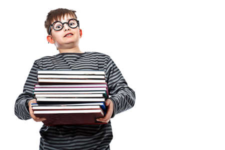 Educational theme: funny teenager with books. Isolated over white background. photo