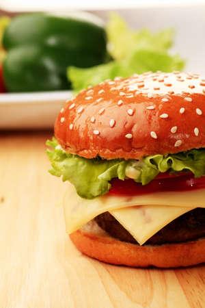 Appetizing cheeseburger. Isolated over white background. photo