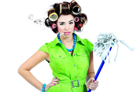 curlers: Shot of a funny  woman housewife dressed in retro style.