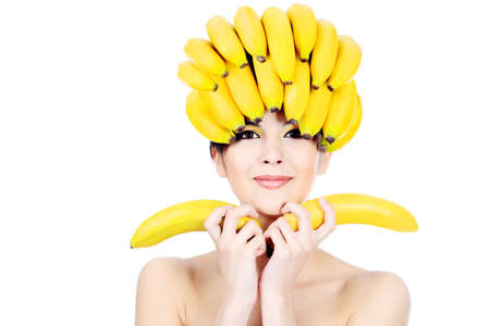 Shot of a beautiful young woman with fruits headwear. Food concept, healthcare.