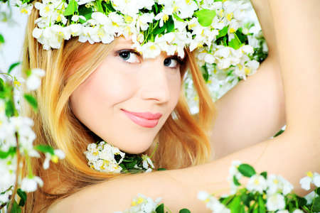 Portrait of a beautiful spring girl in apple tree flowers. Stock Photo - 7469758