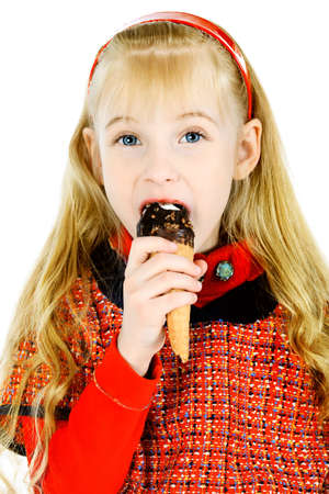 Little girl is eating chocolate ice-cream. Isolated over white background. photo