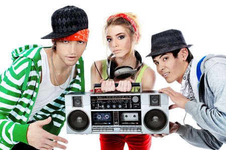 Group of trendy teenagers dancing together. Isolated over white background.  photo