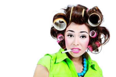 Shot of a funny  woman housewife dressed in retro style. Isolated over white background. photo