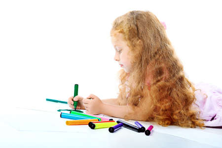 Portrait of a happy girl with felt pens. Isolated over white background. photo