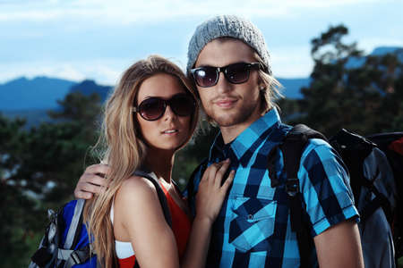 Couple of tourists making their journey at the mountains. Stock Photo - 7498930