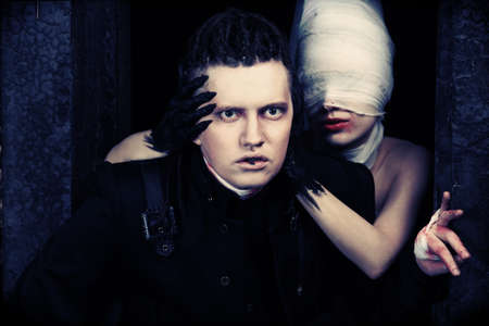 horror movies: Shot of a scary couple in gothic style. Halloween, horror. Stock Photo