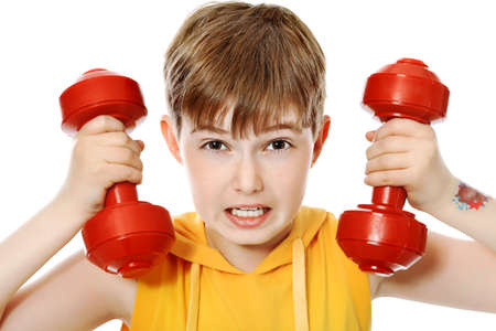 child sport: Shot of a sporty boy teenager with dumbbells. Isolated over white background.