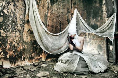 terrify: Shot of a twilight girl in white dress. Halloween, horror. Stock Photo