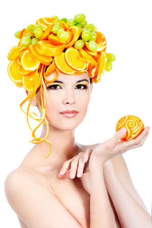 Shot of a beautiful young woman with fruits headwear. Food concept, healthcare. Stock Photo - 7552231